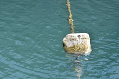 Buoy of plastic barrel floating on water Royalty Free Stock Images