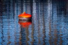 Buoy and reflections. On port stock images