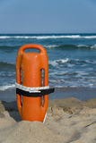 Buoy. A rescue buoy upright into the sand on the beach Royalty Free Stock Image