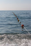 Buoy rope barrier on the water with floats Stock Photo