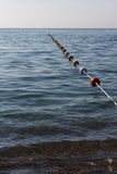 Buoy rope barrier on the water with floats Royalty Free Stock Image