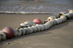 Buoy on the sandy beach in China. Buoy on the beach early in the morning Royalty Free Stock Photos
