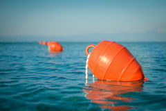 Buoy in the sea. Close up of a buoy floating in the sea, during calm afternoon Stock Image