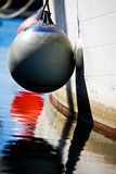 Buoy on side of boat. Buoy tied to side of a fishing boat Royalty Free Stock Photo