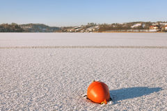 Buoy trapped in the frozen lake Stock Photos