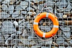 Buoy wall stone. The buoy on stone wall Royalty Free Stock Photography