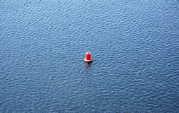 Buoy on water Royalty Free Stock Photo