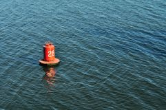 Buoy on the water surface for safe navigation Stock Photo