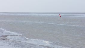 Buoy in the water - Waddensea in the Netherlands. Selective focus Royalty Free Stock Photography