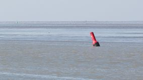 Buoy in the water - Waddensea in the Netherlands. Selective focus Stock Photo