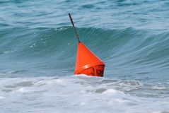 Buoy and waves Stock Images