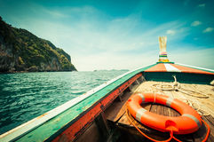 Buoy and wooden boat in the sea Stock Photos