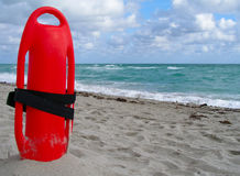 Buoyancy aid. Sticking in the sand ready for use Stock Photography