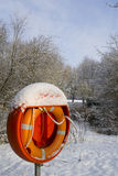 Buoyancy aid. A bouncy aid is covered in snow in this winter scene Royalty Free Stock Photos