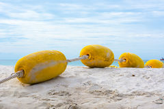 Buoyancy on the beach. Down to the sea Stock Photos
