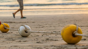 Buoyancy sphere, tied with a rope to use as a barrier for the po. Buoyancy sphere, tied with a rope embed on the beach into the sea. A wide area for tourists to Stock Photo