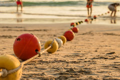Buoyancy sphere, tied with a rope to use as a barrier for the po. Buoyancy sphere, tied with a rope embed on the beach into the sea. A wide area for tourists to Stock Image
