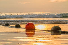 Buoyancy sphere, tied with a rope to use as a barrier for the po. Buoyancy sphere, tied with a rope embed on the beach into the sea. A wide area for tourists to Royalty Free Stock Photos
