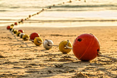 Buoyancy sphere, tied with a rope to use as a barrier for the po. Buoyancy sphere, tied with a rope embed on the beach into the sea. A wide area for tourists to Royalty Free Stock Images