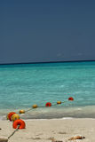 Buoys on the beach. Buoys on a rope stretching into the Caribbean water from a beach in Varadero Cuba Stock Photo