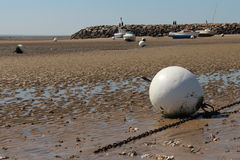 Buoys and boats are failed on the beach in La Bernerie-en-Retz (France) Royalty Free Stock Photo