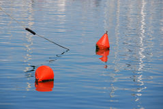 Buoys on calm sea Royalty Free Stock Photo