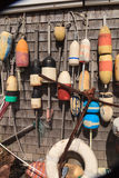 Buoys on a Cape Cod fishing shack. In Massachusetts in summer Royalty Free Stock Images