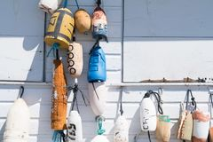 Buoys for Fishing or Lobster. Buoy floats hanging on ropes for fishing or lobster catching catches for professional water seafaring individuals on the ocean and royalty free stock images