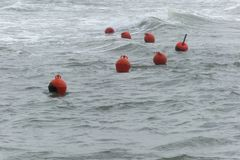 Buoys floating rough sea Royalty Free Stock Images