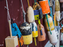 Buoys hanging on wall Stock Photography