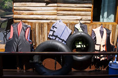 Buoys life jacket wooden wall river adventure Royalty Free Stock Image
