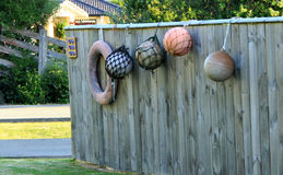 Buoys and a life ring hanging on the fence Royalty Free Stock Photos