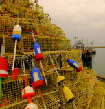 Buoys and lobster pots against a cloudy sky Stock Image