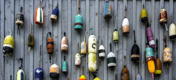 Buoys. Many buoys attached to a general store Stock Photos
