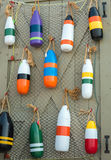 Buoys on net on doorway Royalty Free Stock Photos