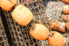 Buoys and nets ready for fishing. Fishing accessories for the serious fisherman.Full of textures Stock Photos