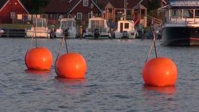 Buoys in Nida resort port, Lithuania stock video