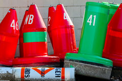 Buoys - Red and Green. Red and Green buoys on land before start of season at Douglas Michigan stock photography