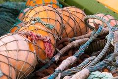 Buoys, ropes and nets Stock Photos