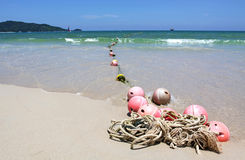 Buoys on sand beach Stock Image