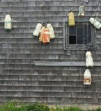 Buoys and a shack. Lobster buoys  hanging against a fishing shack Royalty Free Stock Photography