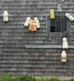 Buoys and a shack Royalty Free Stock Photography