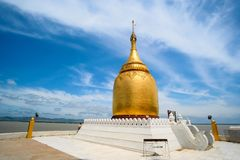 Buphaya Paya Pagoda against blue sky is a golden pagoda located in Bagan in Myanmar near Irrawaddy River royalty free stock photo