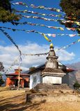 Bupsa gompa monastery and stupa with prayer flags Royalty Free Stock Image