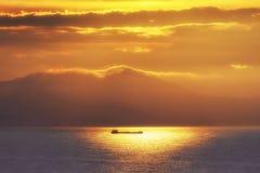 Buque del envío en la puesta del sol Fotografía de archivo libre de regalías