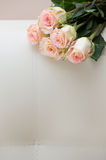 Buquet of tea roses on a white sofa. Bouquet of tea roses on a white sofa Royalty Free Stock Images