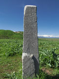 Burana ancient settlement. pole with an inscription in Arabic Stock Photo