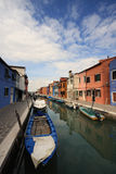 Burano. Colorful houses along one of the waterways of Burano, Venice Stock Image