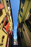 Burano. Colorful houses along one of the typical short streets of Burano, Venice Stock Photo