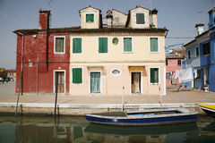 Burano. Colorful houses on the island of Burano in the Venetian lagoon - Italy Stock Photos